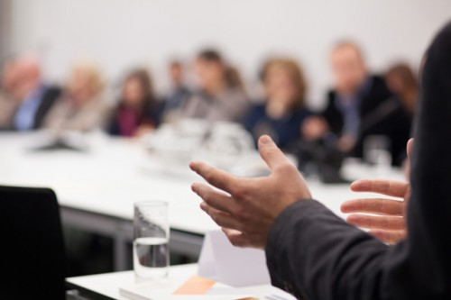 Close-up-of-hands-of-man-giving-presentation-powerpoint-deliver-teach-manager-business-leader-500x333