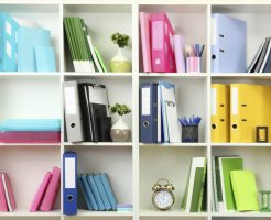 White office shelves with different stationery, close up